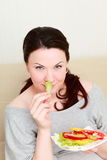 Portrait of young woman with salad Royalty Free Stock Photography
