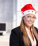 Portrait of young woman in santa claus hat Royalty Free Stock Photography