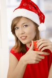 Portrait of young woman with Santa Claus hat Stock Photography