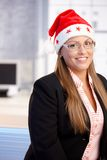 Portrait of young woman in santa claus hat Royalty Free Stock Images