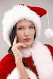 Portrait of young woman in Santa costume Stock Images