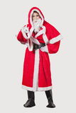 Portrait of young woman in Santa costume gesturing against gray background Stock Photos
