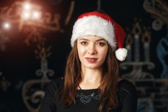 Portrait of a young woman in Santa hat royalty free stock image