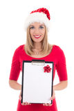 Portrait of young woman in santa hat with wish list isolated on Stock Photo