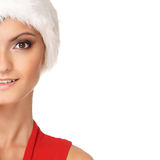 Portrait of a young woman in a Santa winter hat Stock Image
