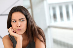 Portrait of young woman with sceptical look. Portrait of girl with doubtful look on her face royalty free stock image