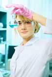 Woman scientist in laboratory Stock Image