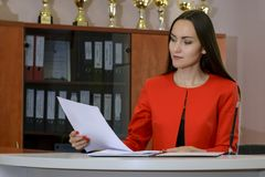 Portrait of young woman secretary signing documents stock image