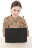 Portrait of young woman in shirt sitting and using laptop Royalty Free Stock Image