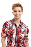 Portrait of young woman in shirt smiling. Portrait of young attractive gingerish woman with short hair Royalty Free Stock Photography