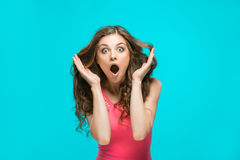Portrait of young woman with shocked facial expression. The portrait of young woman with shocked facial expression Royalty Free Stock Photography