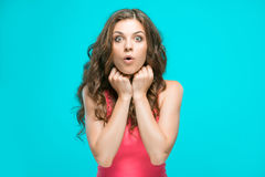 Portrait of young woman with shocked facial expression Royalty Free Stock Images