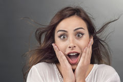 Portrait of young woman with shocked facial expression Stock Images