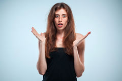 Portrait of young woman with shocked facial expression Royalty Free Stock Photos