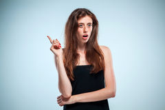 Portrait of young woman with shocked facial expression Stock Photos