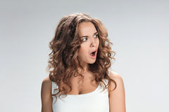 Portrait of young woman with shocked facial expression Stock Photography