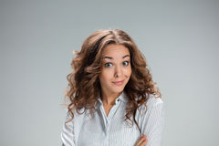 Portrait of young woman with shocked facial expression Stock Image