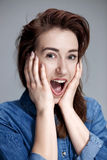 Portrait of young woman with shocked facial expression Royalty Free Stock Photography