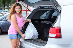 Portrait of young woman shopper after mall near own vehicle Royalty Free Stock Image