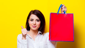 Portrait of young woman with shopping bag Stock Images