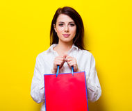Portrait of young woman with shopping bag Stock Photography