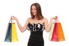 Portrait of young woman with shopping bags stock photos