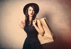 Portrait of young woman with shopping bags Stock Photo