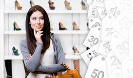 Portrait of young woman in shopping center. Clearance sale Royalty Free Stock Photography