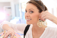 Portrait of young woman shopping earrings Stock Image