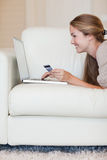 Portrait of a young woman shopping online Stock Photos