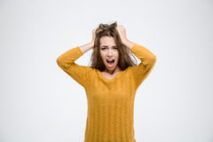 Portrait of a young woman shouting Stock Image