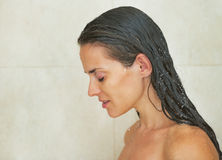 Portrait of young woman in shower Royalty Free Stock Photo