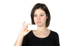 Portrait of young woman showing a business card Stock Image