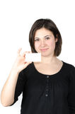Portrait of young woman showing a business card Royalty Free Stock Photography
