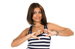 Portrait of young woman showing heart symbol Royalty Free Stock Photos