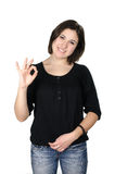 Portrait of young woman showing ok sign Stock Photo