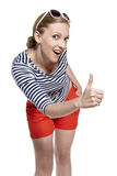 Portrait of a young woman showing thumbs up Royalty Free Stock Photo