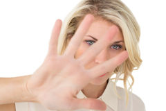 Portrait of young woman signals stop Stock Photo