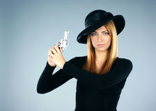 Portrait of a young woman with a silver pistol Stock Photo