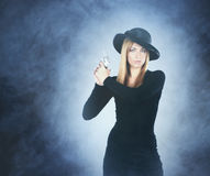 Portrait of a young woman with a silver pistol Stock Images