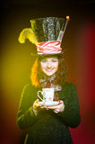 Portrait of young woman in the similitude of the Hatter. (Alice's Adventures in Wonderland royalty free stock photography