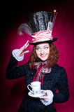 Portrait of young woman in the similitude of the Hatter. (Alice's Adventures in Wonderland stock images