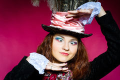 Portrait of young woman in the similitude of the Hatter stock images