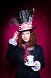 Portrait of young woman in the similitude of the Hatter. (Alice's Adventures in Wonderland stock photo