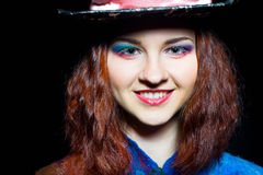 Portrait of young woman in the similitude of the Hatter. Close-up portrait of young woman in the similitude of the Hatter (Alice's Adventures in Wonderland royalty free stock photo