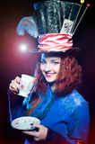 Portrait of young woman in the similitude of the Hatter drinking Royalty Free Stock Images