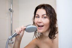 Portrait of young woman singing in shower Stock Photo