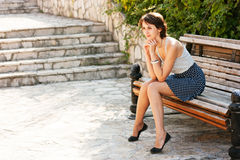 Portrait of Young Woman Sitting on the Bench Royalty Free Stock Images