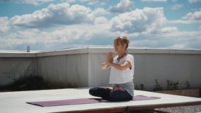 Portrait of young woman sitting in lotus pose and putting hands in namaste. Portrait of beautiful young woman sitting in lotus pose and putting hands in namaste stock video