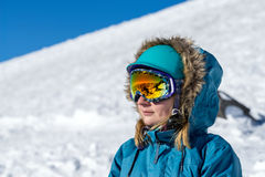 Portrait of young woman at ski resort Stock Photo